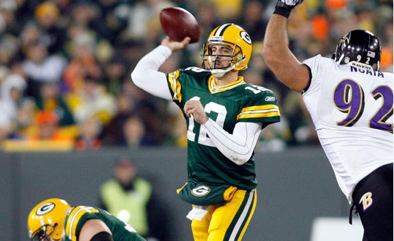Aaron Rodgers throws against the Ravens Monday Night.